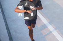 Running Man With Smart Watch. ...