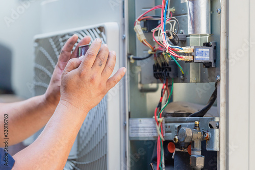 Selective focus of technician man hands using smartphone take a photo air condit Canvas Print