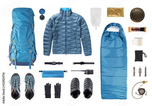 Fototapeta Set of camping equipment and trekking gear isolated on white background. Top view of shoes, clothes and accessories for travel obraz