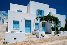 Traditional Greek Architecture Houses Painted White With Blue Doors And Window Shutters