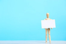 Wooden Figure Holding Blank Bu...