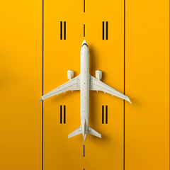 Aircraft model on runway. Concept of aircraft industry, airline safety, security and traveling insurance