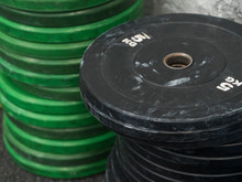 Dirty Black And Green Disc Barbell Stack