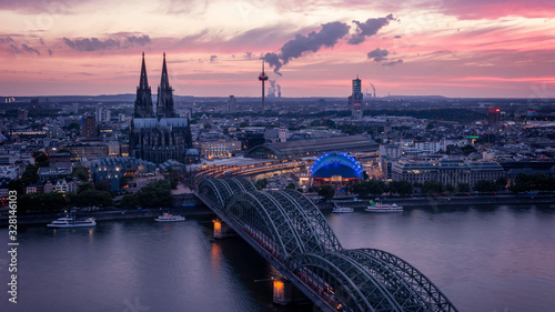Leinwand Poster Koln Germany city skyline, Cologne skyline during sunset ,Cologne bridge with ca