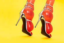 Close Up Of Orange Inflated Balloons In Stilettos