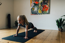 Young Child Girl Exercising At...