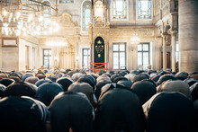 Rear View Of Men Praying In Mosque