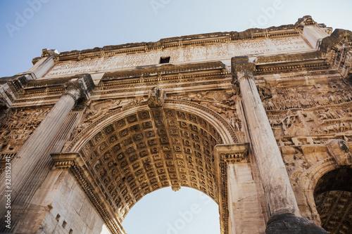 Fototapeta The Arch of Titus is located in Roman Forum