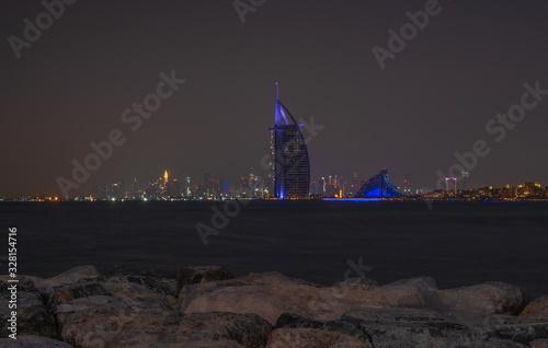 фотография DUBAI - may 2019: Burj Al Arab the luxury seven star Dubai hotel at night