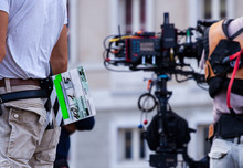 Film Crew Team Filming Movie Scene On Outdoor Location