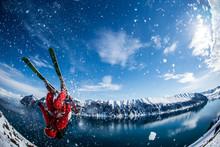 Man Performing Flip On Skis In...