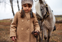 Girl Leading Her Pony By Bridle