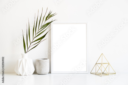 White frame and home decoration details on tabletop with wall, artwork poster mo Canvas Print