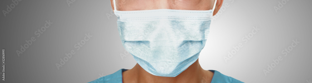Fototapeta Coronavirus surgical mask doctor wearing face protective mask against corona virus banner panoramic medical professional preventive gear.