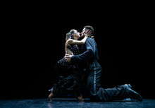 Couple Of Dancers Performing On Isolated Black Background