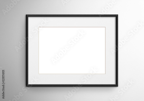 Empty frame. Blank black mounted landscape frame on white wall