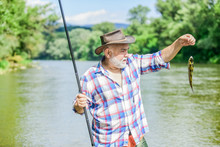 Lets Go Fishing. Summer Weekend. Big Game Fishing. Retired Bearded Fisher. Trout Bait. Fisherman With Fishing Rod. Hobby And Sport Activity. Pothunter. Mature Man Fly Fishing. Man Catching Fish