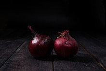 Red Onion On A Wooden Backgrou...
