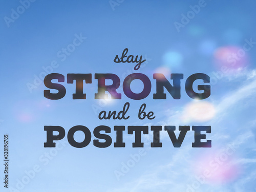 Photo Stay strong and be positive word on blue sky colorful bokeh background