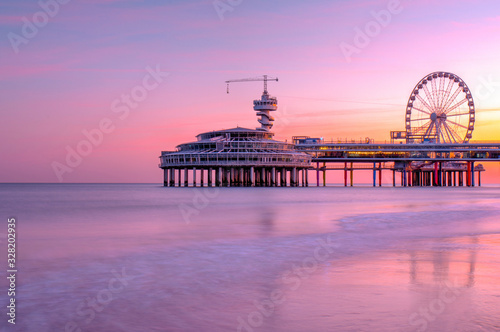 The pier jetty of scheveningen beach in Hague, den Haag #328202935