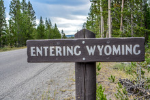 "WYOMING USA A Sign ""Entering Wyoming"" Sign On A Back Road."