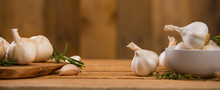 Garlic Banner, Background. Spices, Bulbs Of Garlic On A Wooden Rustic Table In The Shape Of A Panorama. A Bunch Of Garlic Peeled Cloves