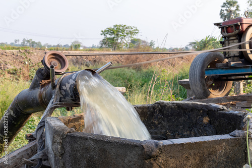 Pumps, water pipelines pumped into the fields to alleviate drought Canvas Print