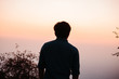 Silhouette of a man during sunset at Sunset Point in Mount Abu, Rajasthan, India