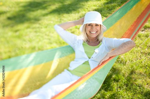 Stampa su Tela Happy senior woman in a park