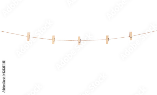 Fotomural Wooden clothes pins hanging on brown rope  isolated on white background