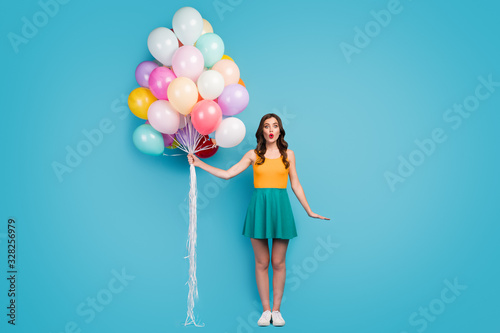 Full length photo of astonished girl celebrate her birthday with friends recieve Canvas Print