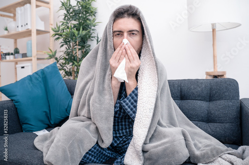 obraz PCV Man portrait suffering cold and flu at home
