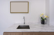 Modern faucet and wash basin sink on white marble counter with wooden photo frame space for advertising, yellow orchid flower