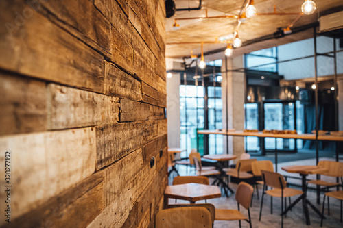 Obraz View on wooden wall and coffee shop in blurred background - fototapety do salonu