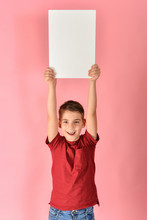 The Boy Holds A Blank Poster F...
