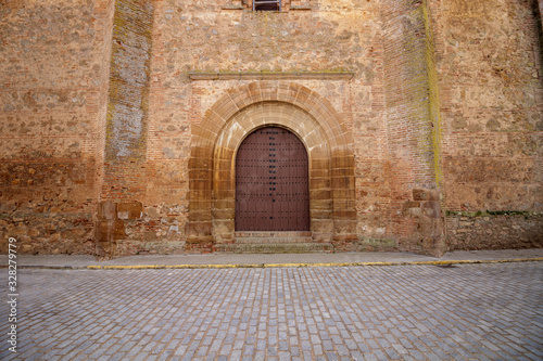 Valokuvatapetti Large arched wooden door at the rear of an old church in Spain