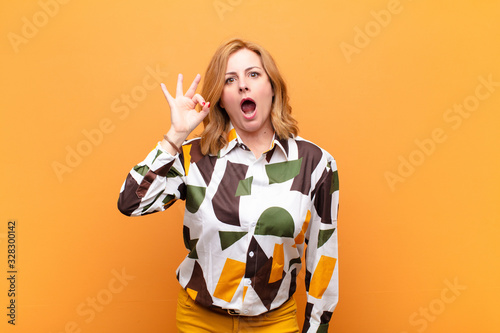 middle age woman feeling successful and satisfied, smiling with mouth wide open, Wallpaper Mural