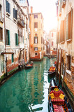 Scenic canal with gondolas in Venice, Italy. Famous travel destination