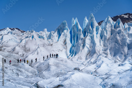 Fotografie, Obraz Tourists Trekking on Perito Moreno Glacier in Los Glaciares National Park Near E