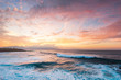 canvas print picture - Tropical Island Paradise Aerial Photo of Clear Aqua Blue Ocean Water with Waves Crashing on Rocks with Sun Rays Coming Though Clouds of Colorful Pastel Sunset Sky at Dusk on Maui Hawaii