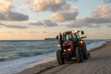 Tractor Cleaning The Beach In ...