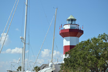 Lighthouse Behind Trees And With Yachts In Harbor Town, Hilton Head Island.