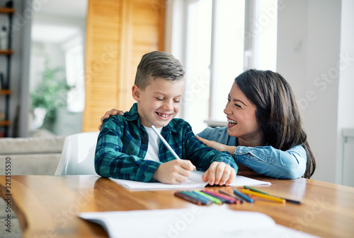 Fotografiet homework teaching education mother children son familiy childhood