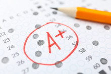 Test Score Sheet With Answers, Grade A  And Pencil, Close Up