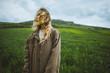 Windswept woman in field in Crimea, Ukraine