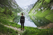Woman By Mountains And Lake In...