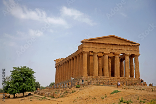 The Temple of Concordia, a 5th-century BC, Doric-style Ancient Greek temple in the Valley of the Temples, a UNESCO World Heritage Site in Agrigento, Sicily, Italy .