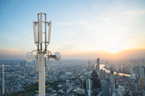 Canvastavla Telecommunication tower with 5G cellular network antenna on city background