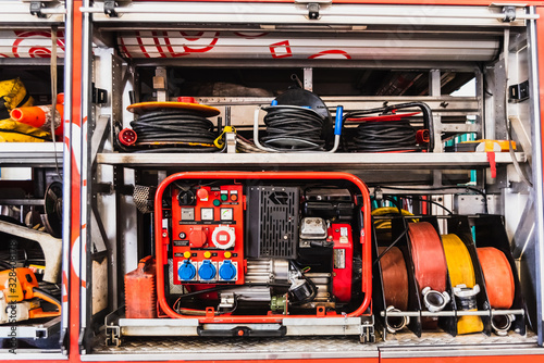 Photo Emergency material of a fire truck, with generator set and hoses.