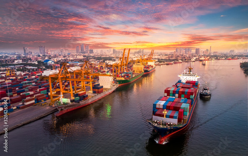 mata magnetyczna Logistics and transportation of Container Cargo ship and Cargo plane with working crane bridge in shipyard at sunrise, logistic import export and transport industry background